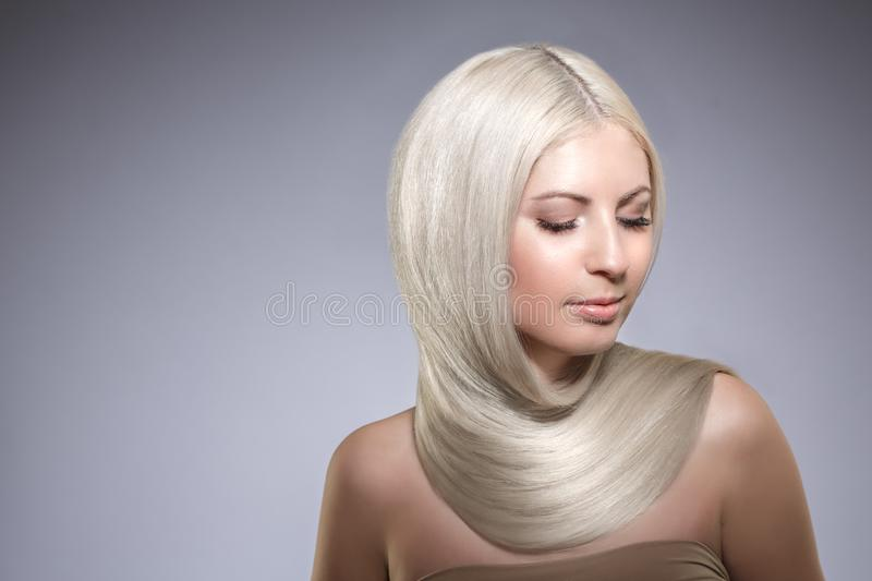 Model blonde with long healthy shiny hair. Woman wearing hair stock photography
