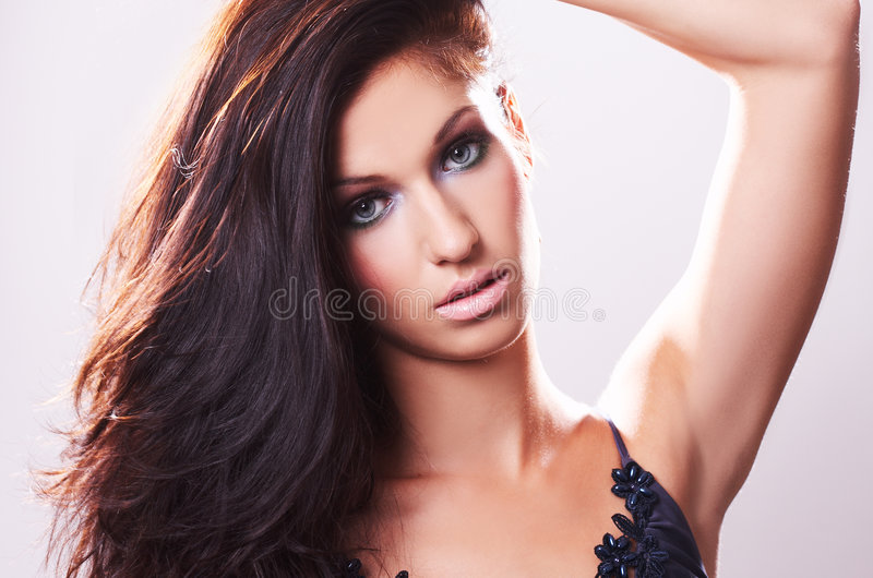 Model in blue blouse and whispering hair royalty free stock photos