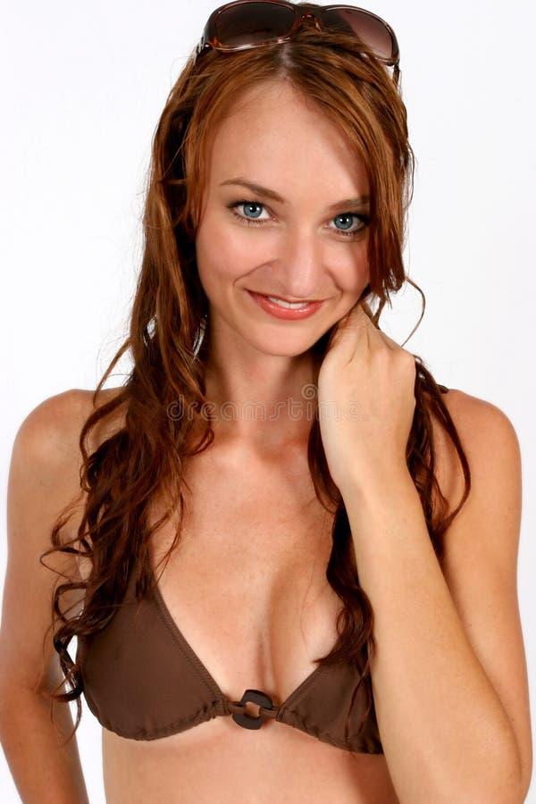 Model Brown Bikini. Brunette woman with bikini on and sunglasses on her head stock images