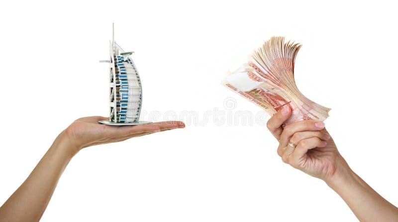 Model Burj Al Arab And Money In Wom Royalty Free Stock Photos