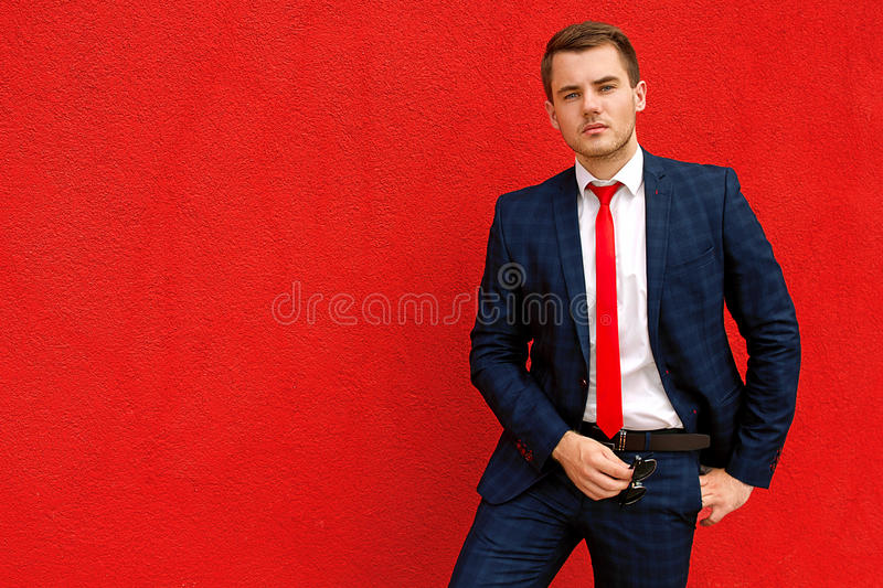 Model businessman in a blue suit and tie royalty free stock photos