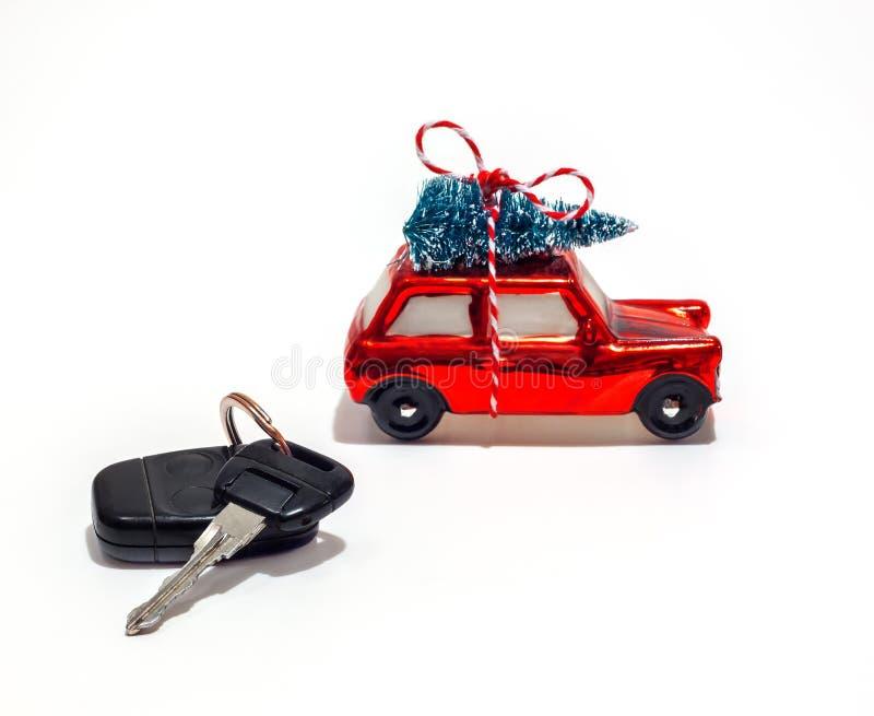 Model car, Christmas. Model car keys Christmas tree on a white background, Christmas holiday royalty free stock photos