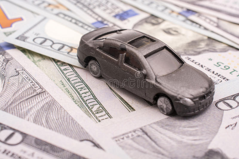 Model car placed US dollar banknotes. Spread on ground stock photography