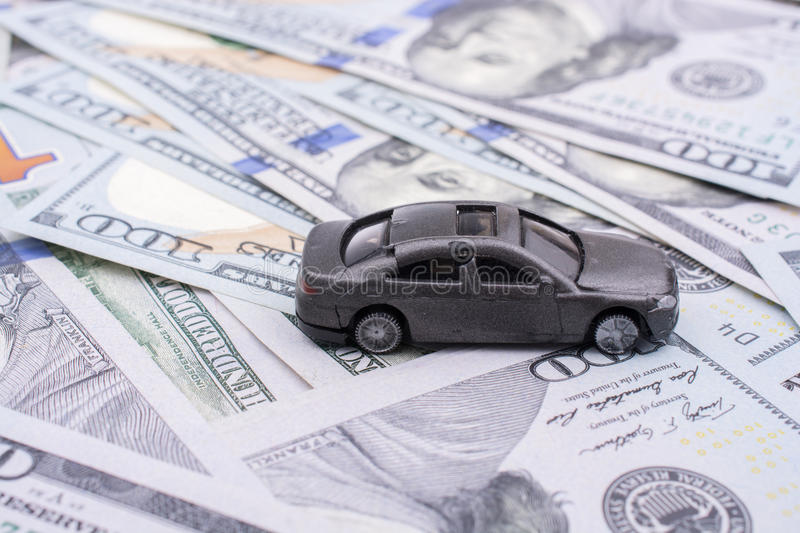Model car placed US dollar banknotes. Spread on ground royalty free stock photos