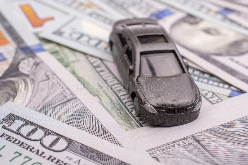 Model car placed US dollar banknotes. Spread on ground stock photos