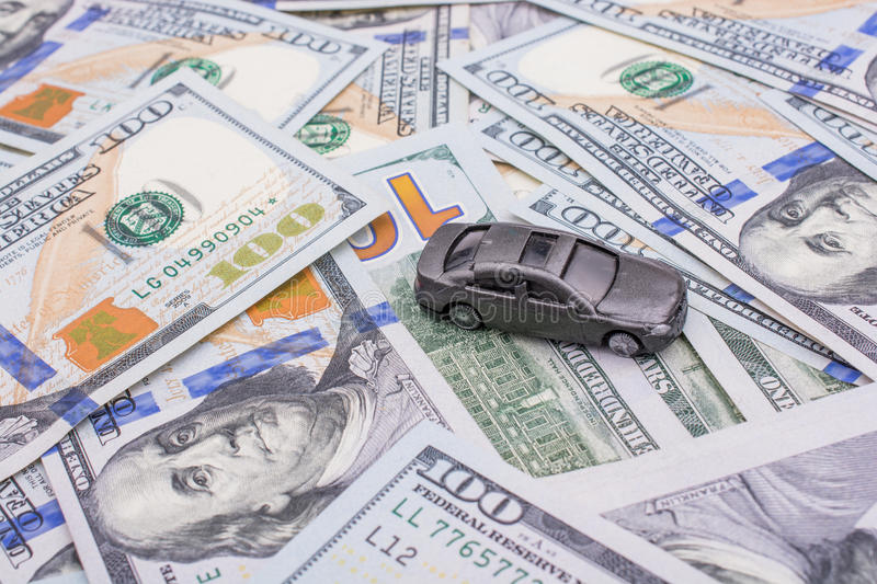 Model car placed US dollar banknotes. Spread on ground royalty free stock photo