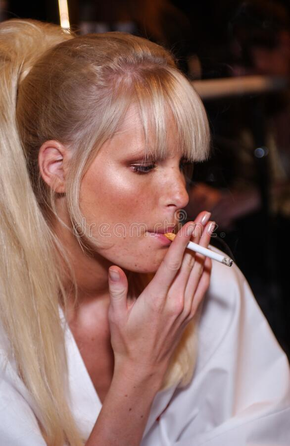 Free Model Caroline Winberg Smoking Cigarette Backstage For Fashion Show Of Valentino Ready-To-Wear Collection Royalty Free Stock Photos - 195542608