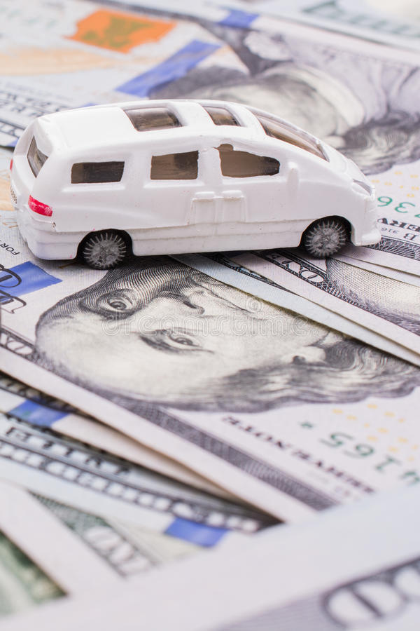 Model cars placed US dollar banknotes. Spread on ground stock images