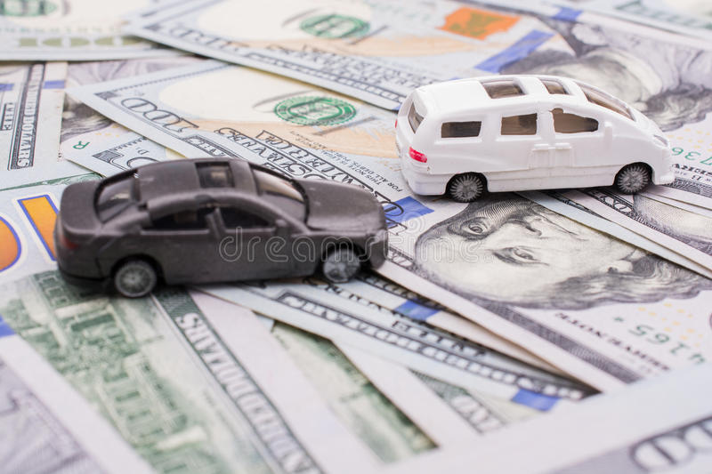 Model cars placed US dollar banknotes. Spread on ground royalty free stock photography