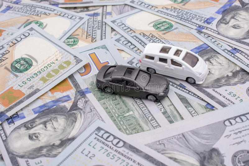 Model cars placed US dollar banknotes. Spread on ground stock photography