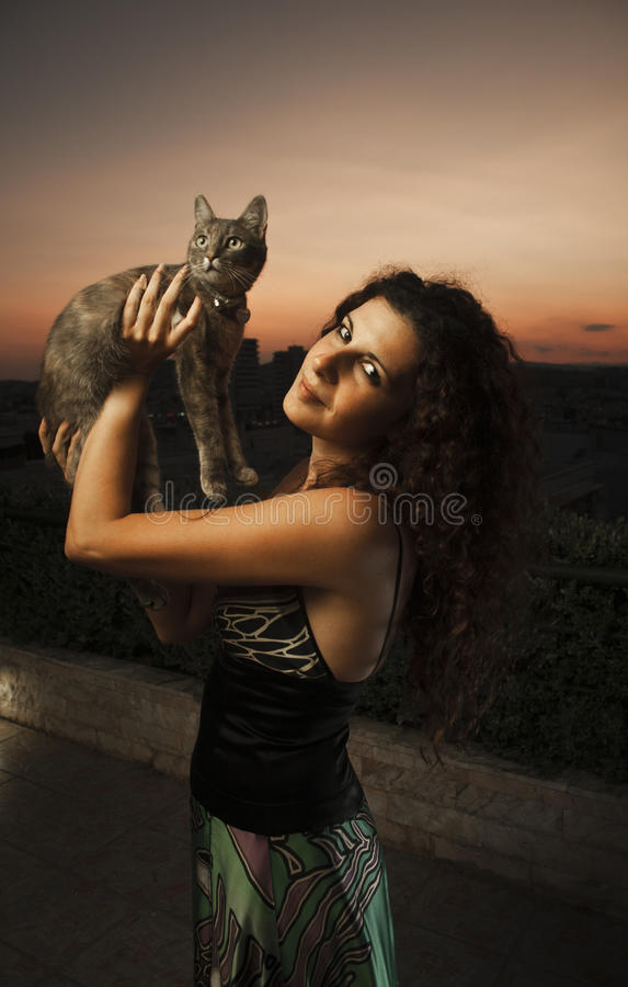 The model and the cat stock photos