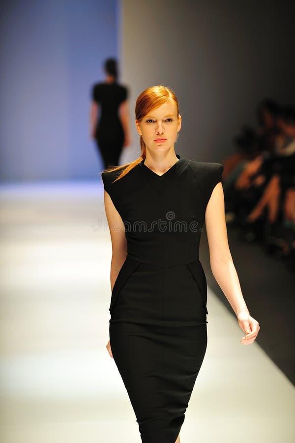 Model cat walking during Audi Fashion Festival stock photo