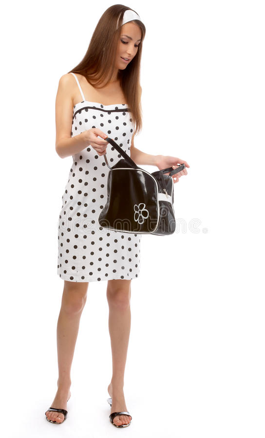 Model checks her bag stock images