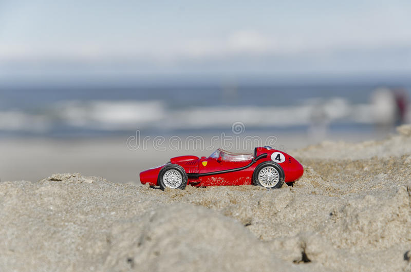 Model of a classic Formula one car on the beach. View of model of a classic Formula one car on the beach royalty free stock images