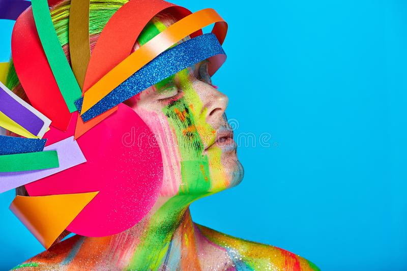 Model with colorful abstract makeup in multicolored helmet stock images