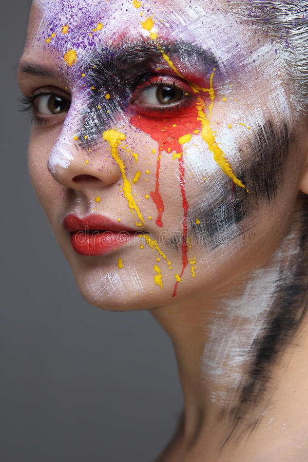 model with colorful artistic makeup stock images