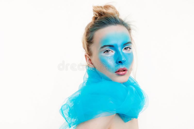 Model with a creative art make-up on her face royalty free stock image