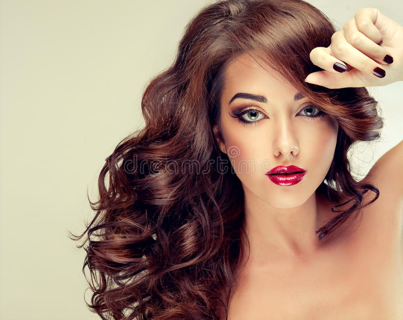 Model with dense, curly hair and black manicure. royalty free stock photography