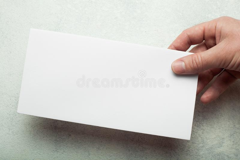 Model DL flyer with shadow in hand.  stock photos