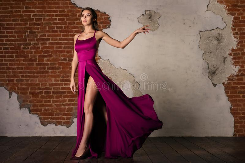 Model in Elegant Dress, Woman Posing in Flying Silk Cloth Waving on Wind, Beauty Fashion Portrait stock images