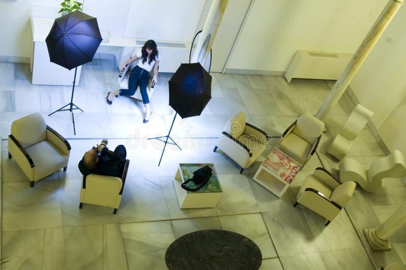 Model en fotograaf stock afbeeldingen
