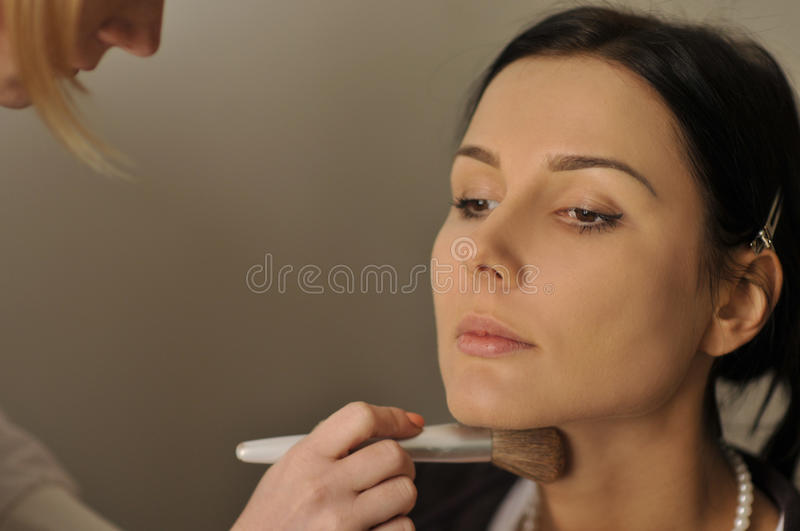 Model face close-up during professional makeup pro stock photography