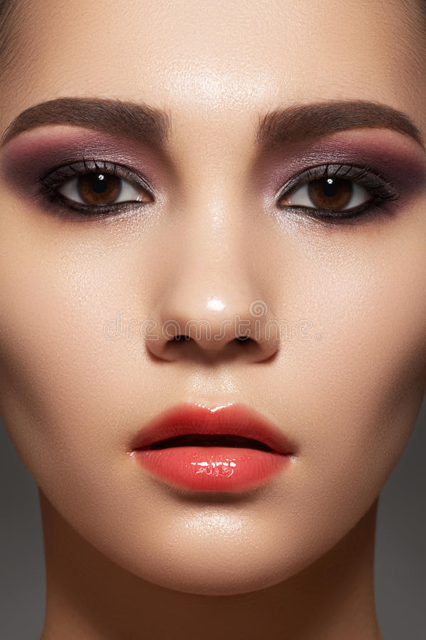 Model face with shiny clean skin, fashion make-up