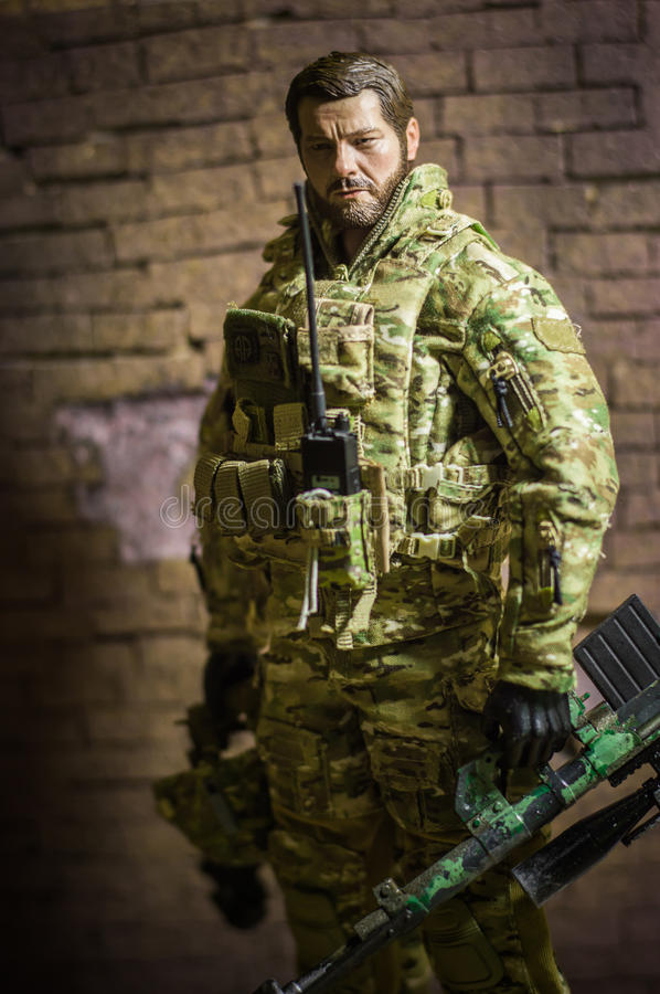 Miniature realistic toys man soldier figure stock photography