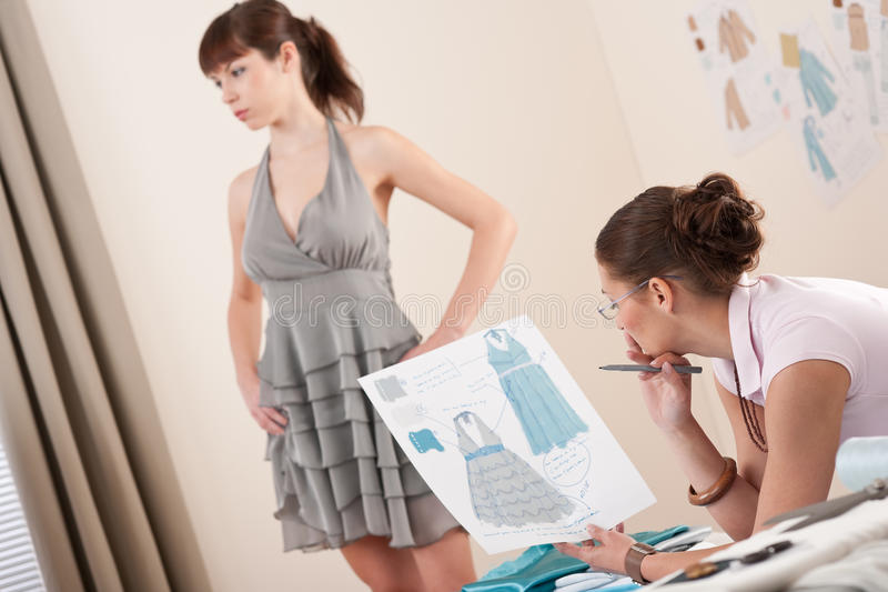 Download Model Fitting By Female Fashion Designer Stock Image - Image of sketch, creative: 12087539