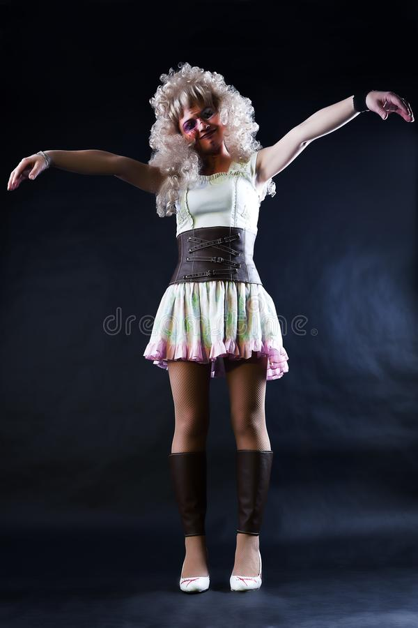 Model in form of creepy doll. On dark background with nice lags stock photos