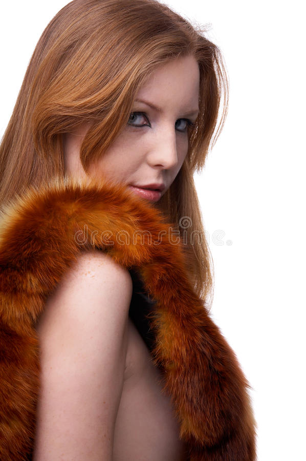 Model in fur scarf. Portrait of beautiful redhead pale skinned model with fox fur scarf stock photo