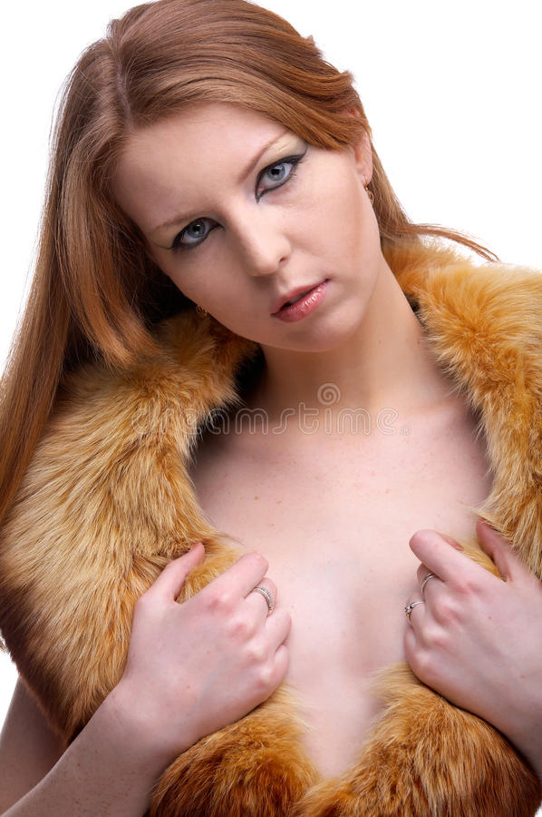 Model in fur scarf. Portrait of beautiful redhead pale skinned model with fox fur scarf royalty free stock images