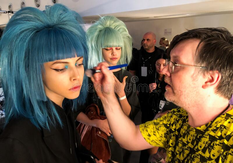 A model getting ready backstage for the Jeremy Scott runway show stock image