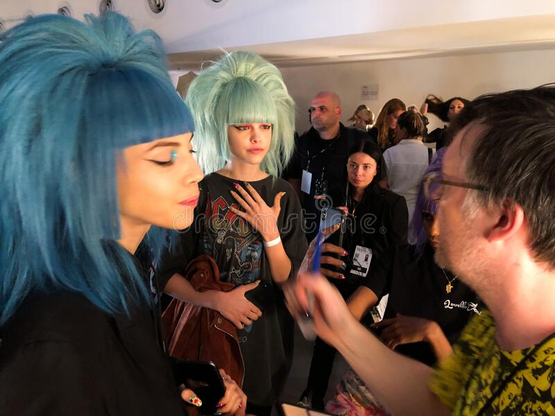 A model getting ready backstage for the Jeremy Scott runway show royalty free stock photos