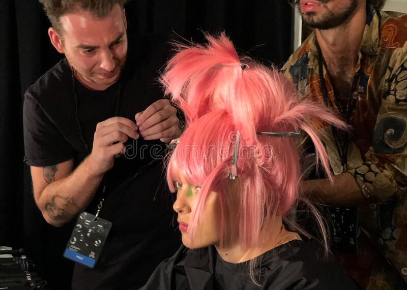 A model getting ready backstage for the Jeremy Scott runway show stock photos