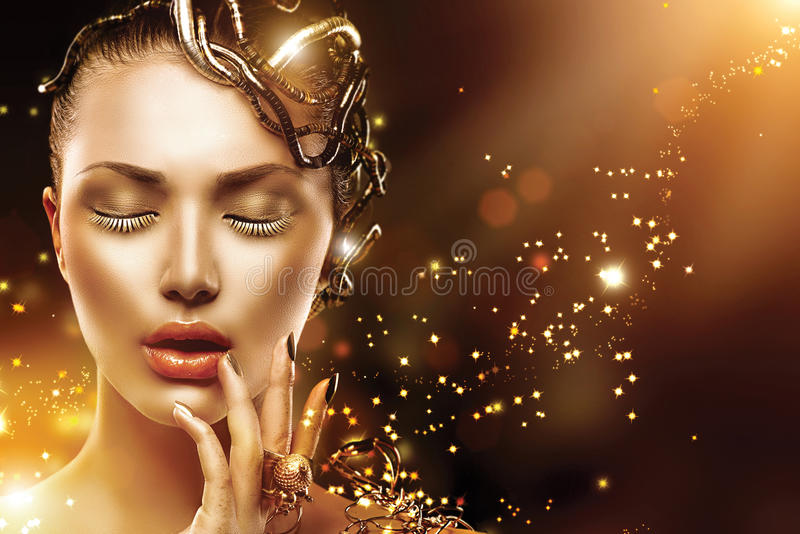Model girl face with gold make-up and accessories stock photo