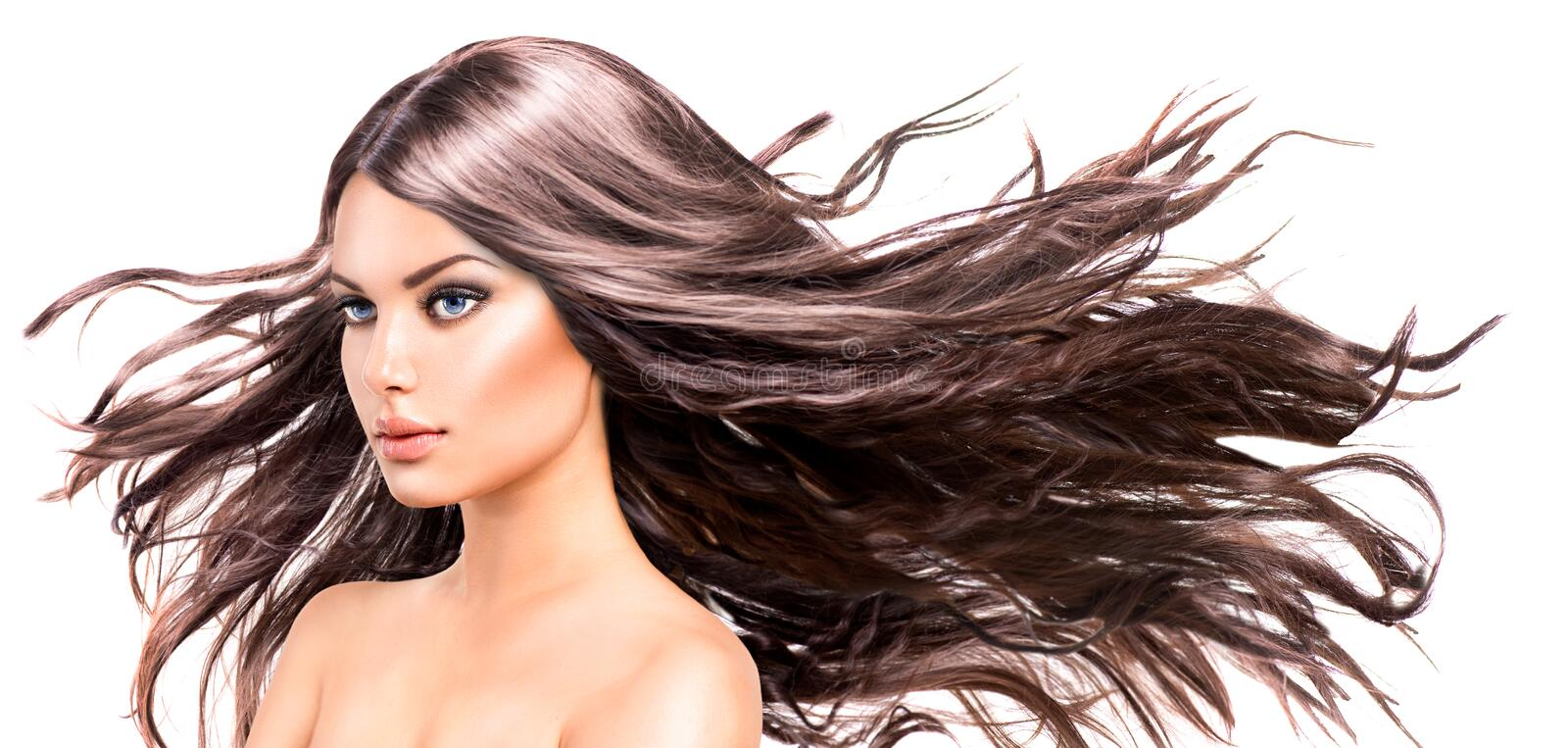 Model Girl with Long Blowing Hair. Fashion Model Girl Portrait with Long Blowing Hair royalty free stock images