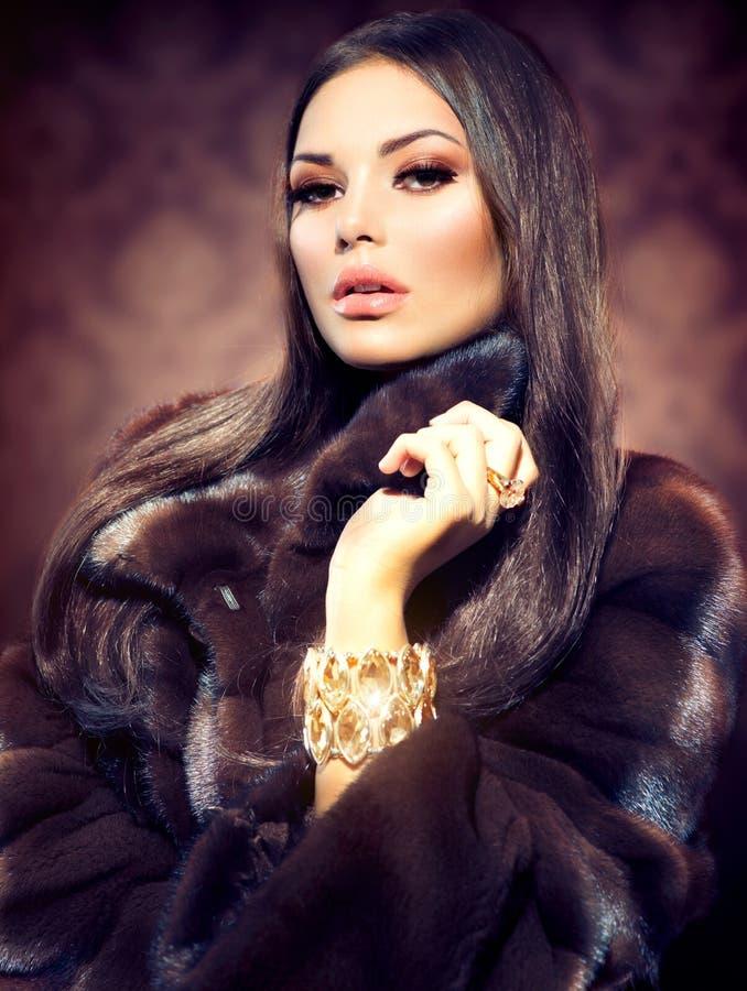 Model Girl in Mink Fur Coat royalty free stock photography