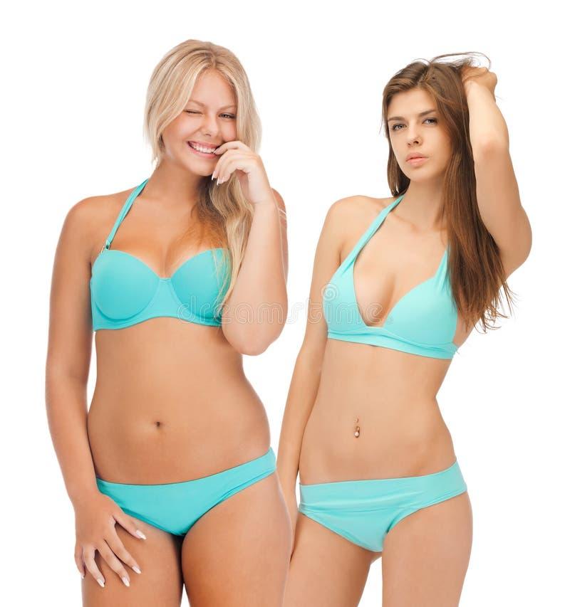 Model girls in bikinis. Summer, bikini and fashion concept - model girls in bikinis royalty free stock photo