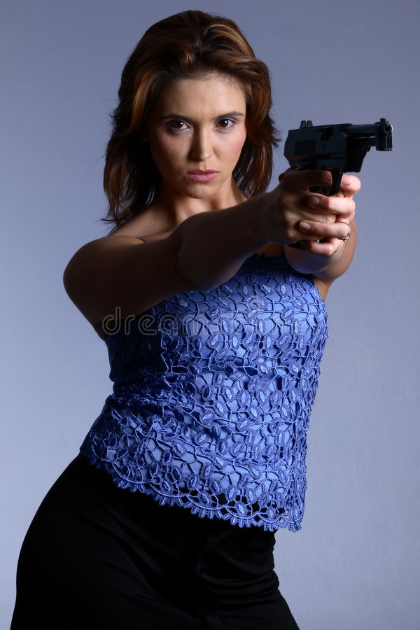 Download Model With Gun Stock Photo - Image: 1559170
