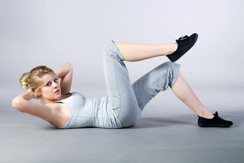 Model with gymnastic exercises. Young model with gymnastic exercises stock photo