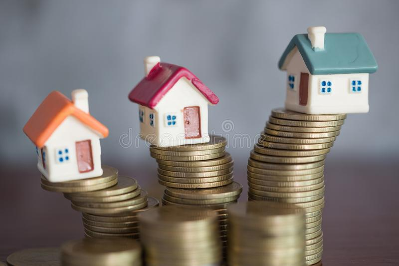 Model home and coin , Saving money for buy a new house and loan for plan business investment for real estate in the future concept royalty free stock image