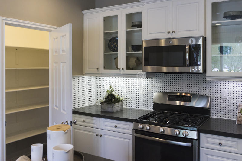 Model home kitchen and pantry. royalty free stock photos