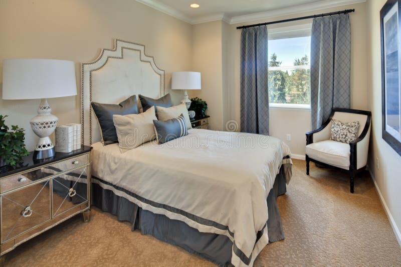 Model Home Master Bedroom. Designer model home master bedroom with window showing sunny blue sky stock images