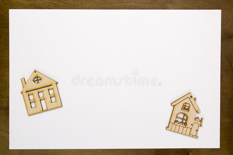 Model home on a white sheet of paper. On a wooden table royalty free stock images