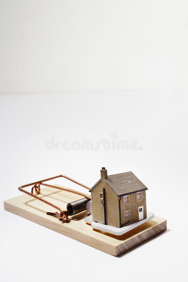 Model house as bait on mousetrap stock image