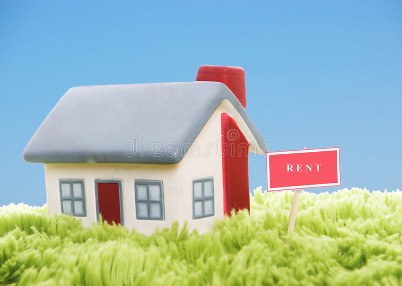 Model of house on blue sky background stock photography