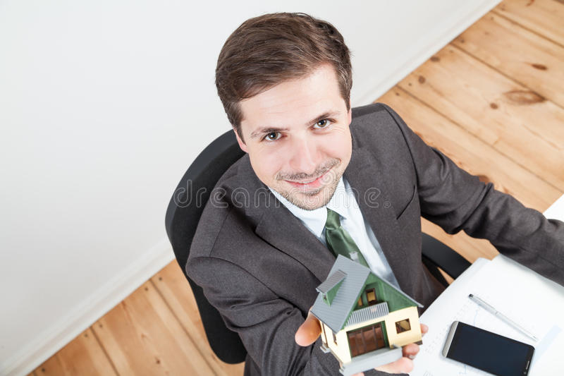 Model house in businessman hands stock image
