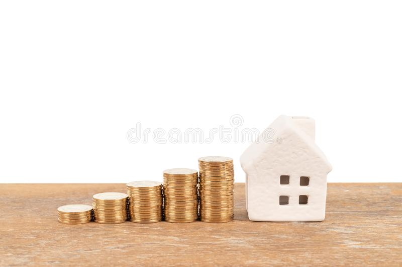 Model house and coin stack on white background mortgage saving concept.  royalty free stock photography