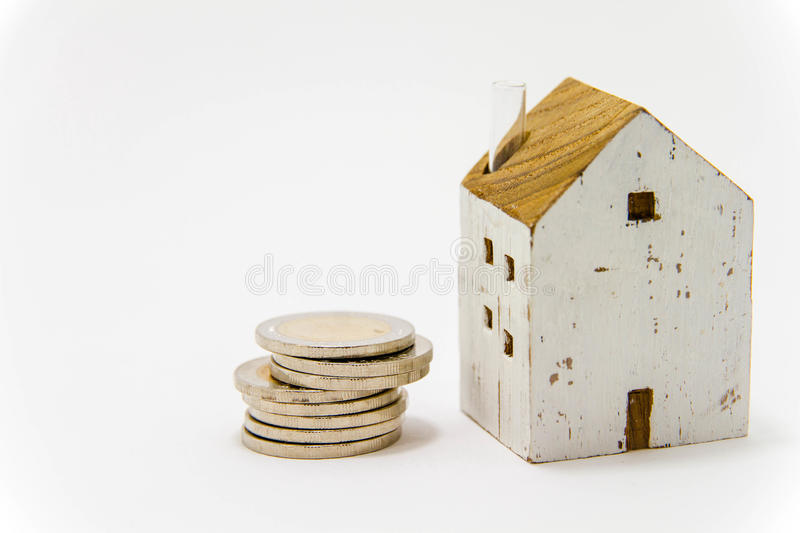 Model of house with coins. Buy house, Start a family, Home loans royalty free stock photography
